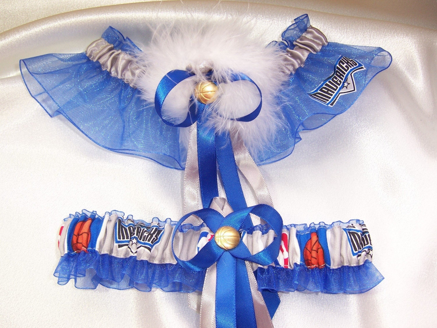 ... blue and silver ribbons, a sexy marabou pouf, and a basketball charm.