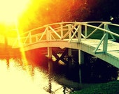 Crossing Over: bold, bright, inspiring fine art photograph print of white bridge over water with yellow and orange sun light and green grass - UninventedColors