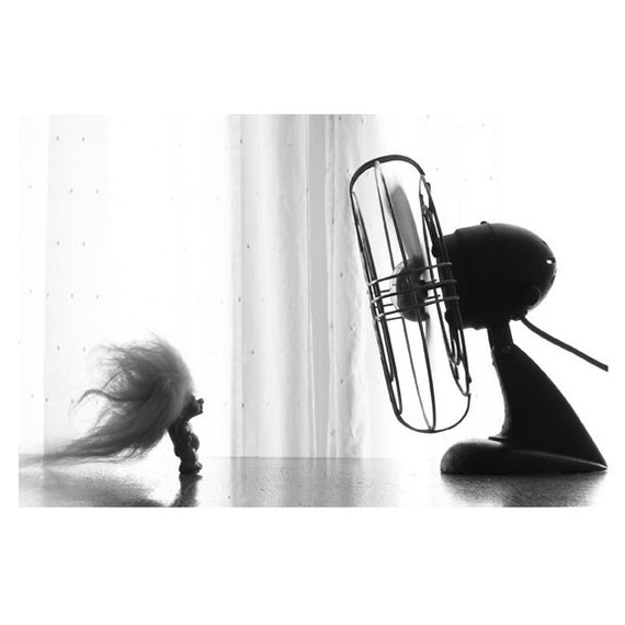 toy with hair blowing in the fan photography