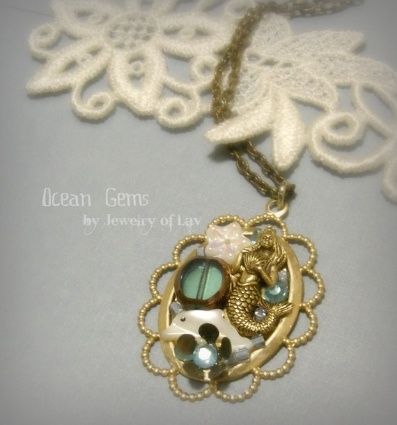 Ocean Gems made with mermaid charm, shell dolphin, flower charm, glass beads, etc.