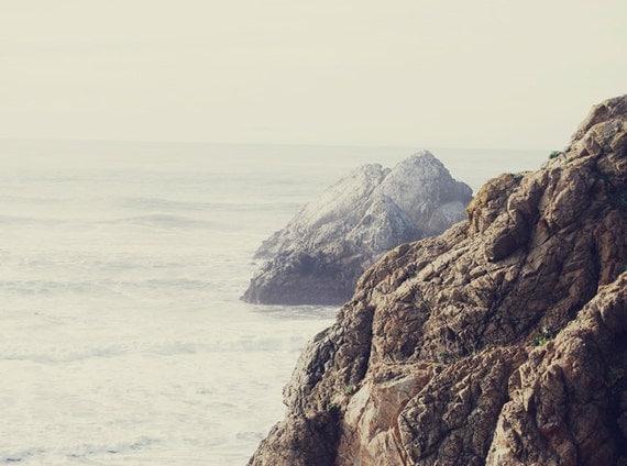 craggy rock coastline with ocean view in haze