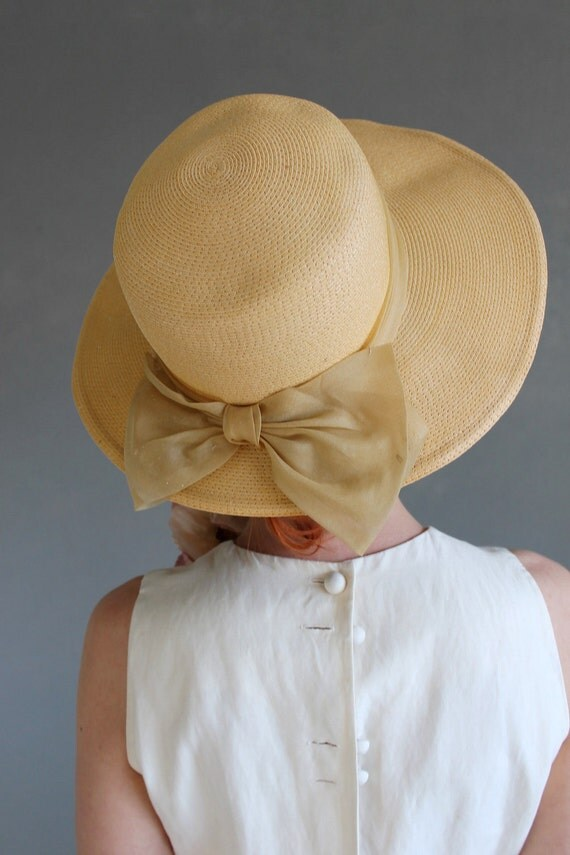 yellow woven vintage hat with bow and wide brim