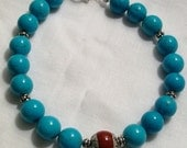 Handmade Mens Turquoise Beaded Bracelet with Red Tibetan Bead Accent and Silver Spacers