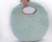 Felted aquamarine colour summer handbag.