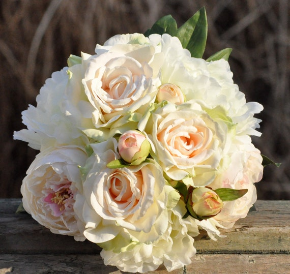 Blush peony and rose wedding bouquet made of silk flowers.