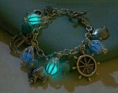 Mermaids Magic Charm Bracelet - Featuring Mini Mermaid's Magic and Ocean Inspired Charms and Gemstones - Amazing Glow in the Dark Effects - Clover13