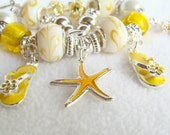 Yellow and White Swirl European Beaded Charm Bracelet with Ocean Charms - GirlieGals