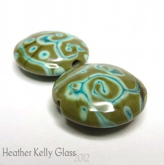 Heather made this pair of lentil beads with an olive green base and scrollwork in a minty green
