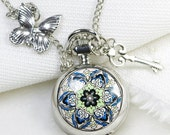 blue flower silver pocket watch necklace with a bute butterfly and key - tonightstar
