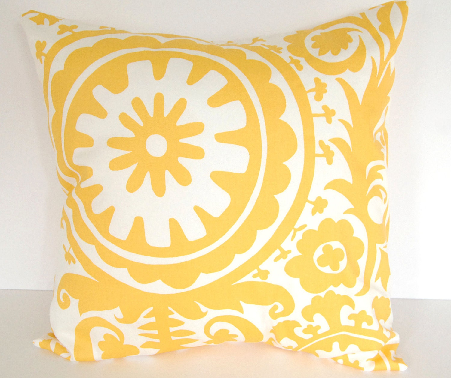 yellow decorative throw pillow