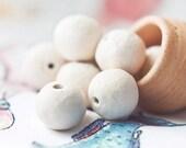 Set of eight simple white handmade ceramic beads - EmeraldFlameCrafts