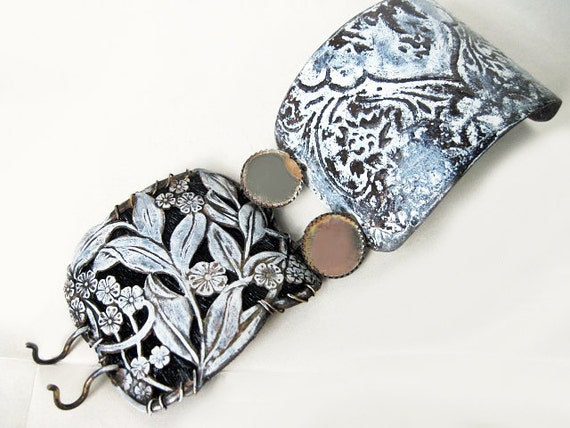 Sophia. White Patina Cuff with stamping over cowhide, etched salvaged tin and mirror buttons.