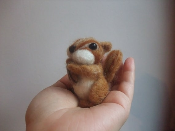 Needle felted squirrel with a nut