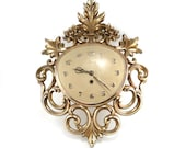 Syroco wall clock - Hollywood Regency gold filigree - reconstitutions