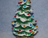 Handpainted ceramic Lighted Christmas Tree covered in little round multi colored bulbs and a yellow star with snow tipped branches - FlutterbyConnections