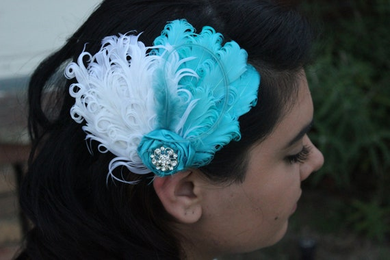 The Zelda--white and blue najorie feather with rhinestone button