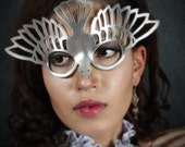 Bird mask in metallic silver leather