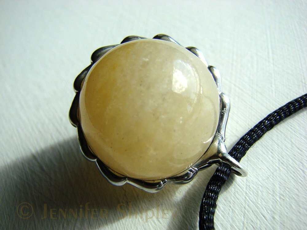 Milky Quartz Sphere Pendant Available at https://www.etsy.com/listing/109785418/milky-quartz-sphere-pendant-iron-stained