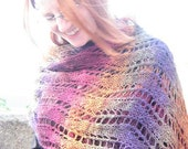 knitted wool wrap in magenta, golden orange, purple, and green