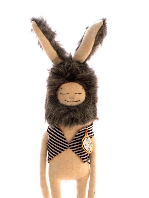 Grey Alice Rabbit, in a stripy waistcoat