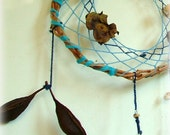 Baby mobile earth art magical dream catcher weaved in 2 shades of blue with black pods, white feather and many natural surprises. - MammaEarthCreations