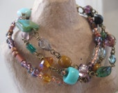 Sunset by the Sea - Exotic Teal, Amber, Amethyst,  Aqua, and Burnt Orange Colored Beads - Layered Bracelet - Etoiles - Stars in French Charm - TheFirstKiss