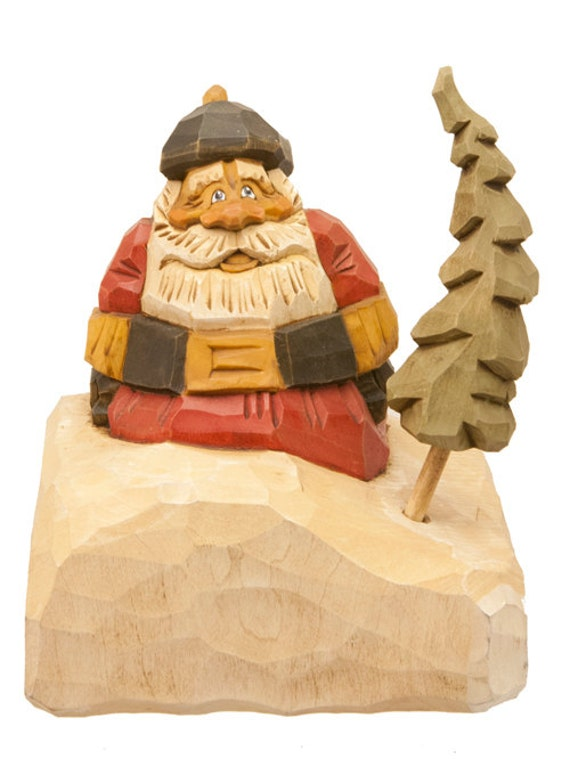 Hand Carved Wooden Santa in Snowbank with Traditional Red Coat and Black Hat
