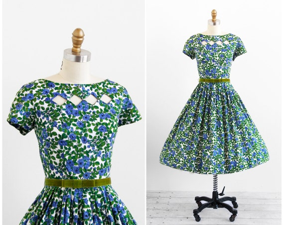green and blue vintage women's party dress from the 50s
