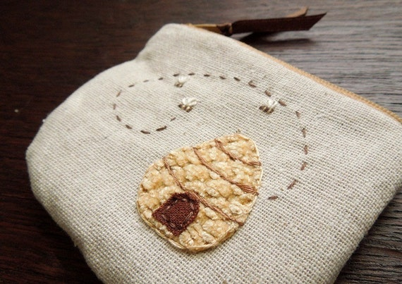 hand embroidered zipper pouch with honey bee hive