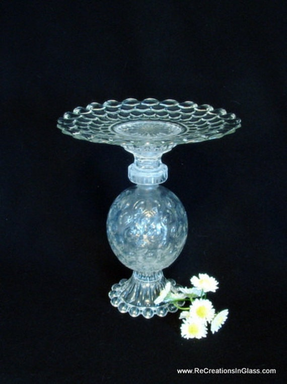 "Pedestal stand for candle, plant, or food server.  ""The Marla"" is made with repurposed upcycled glass."