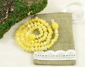 Baltic Amber Baby teething necklace milky, polished, baroque beads in Lovely Linen gift bag