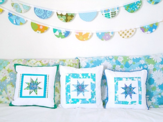 vintage fabric bunting and star patchwork cushion covers