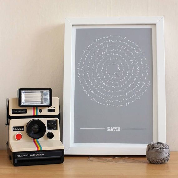 Morse code message printed in the shape of the moon