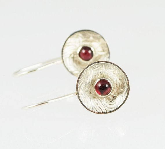Sterling silver  round cup earrings, textured and set with 4mm garnet cabochons.