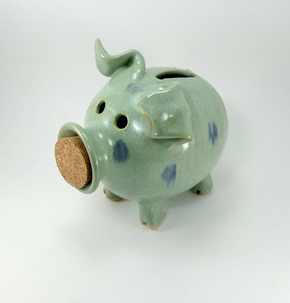 spotted light green piggy bank