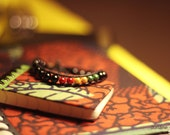 Reggae Black Pearls - Wrap bracelet made of beautiful asian black beads, Reggae shining colors, original clasp