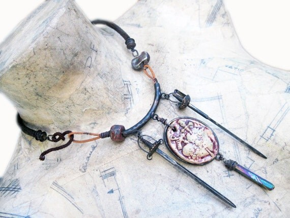The Shiva Hypothesis. Rustic Choker Dark heart swords vintage antique recycled with raku ceramics.