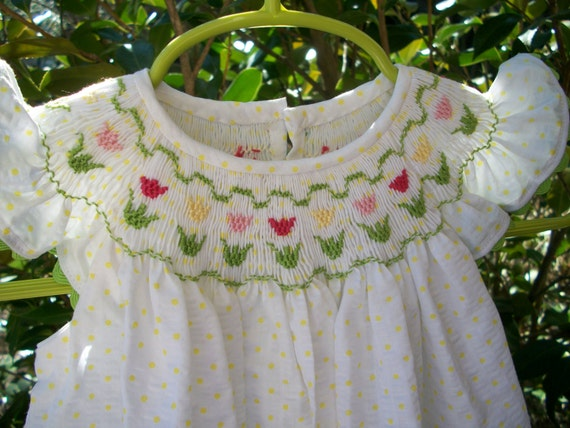 Handsmocked white yellow dot plisse bishop with tulips