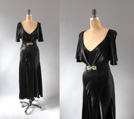 Bias cut evening gown in black satin with rhinestone deco brooch