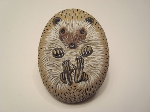 Hedgehog hand painted on a stone - pet rock.
