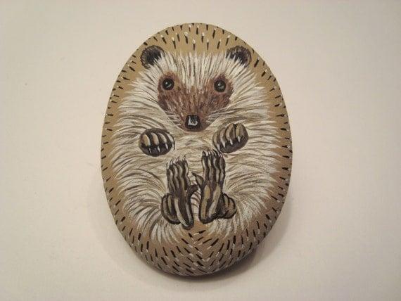 Hedgehog hand painted on a stone - pet rock.