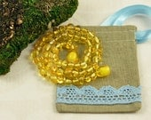 Baltic Amber Baby teething necklace lemon, polished, baroque beads in Lovely Linen gift bag