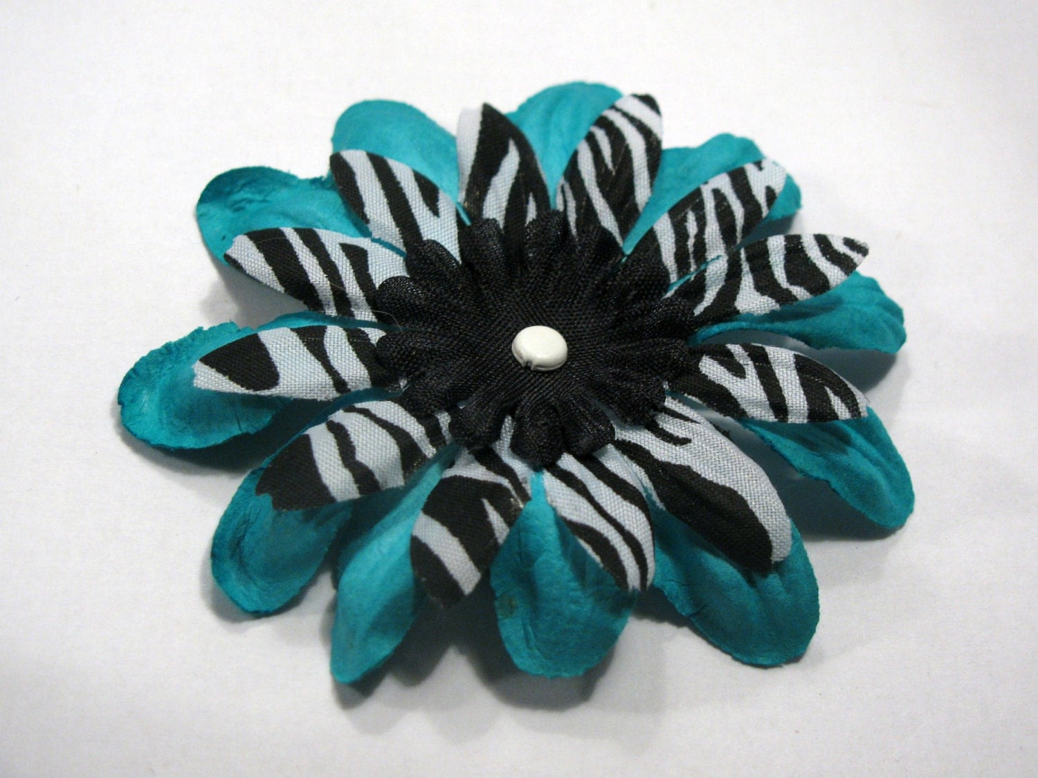 Turquoise and black zebra hair flower clip by VivaVegaBoutique from etsy.com