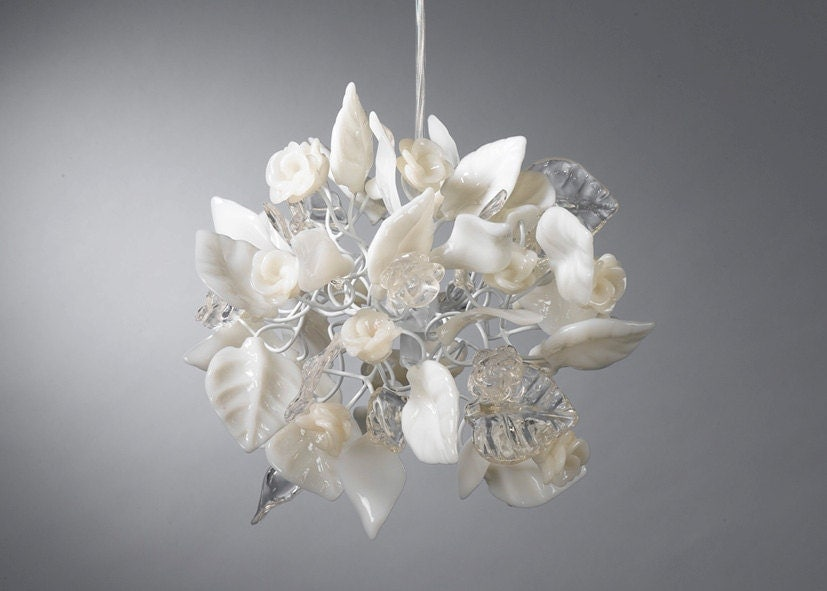 Ceiling chandelier. Crystal clear and white flowers and leaves.