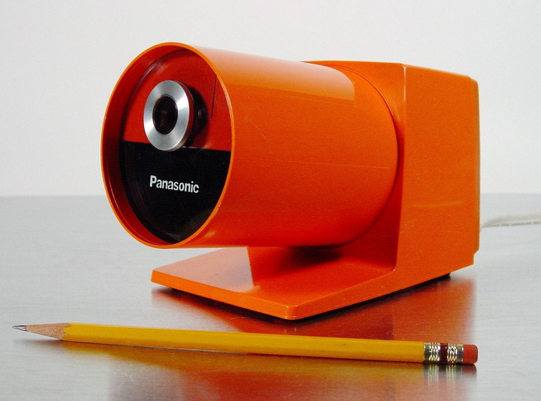 Midcentury Modern Orange Electric Pencil Sharpener by Panasonic, model KP-22A Pana-Point Mod Pop Art Pencil Sharpener, 1970s. - ClubModerne
