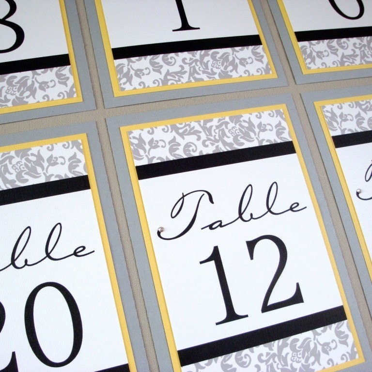 grey and yellow wedding table arrangements