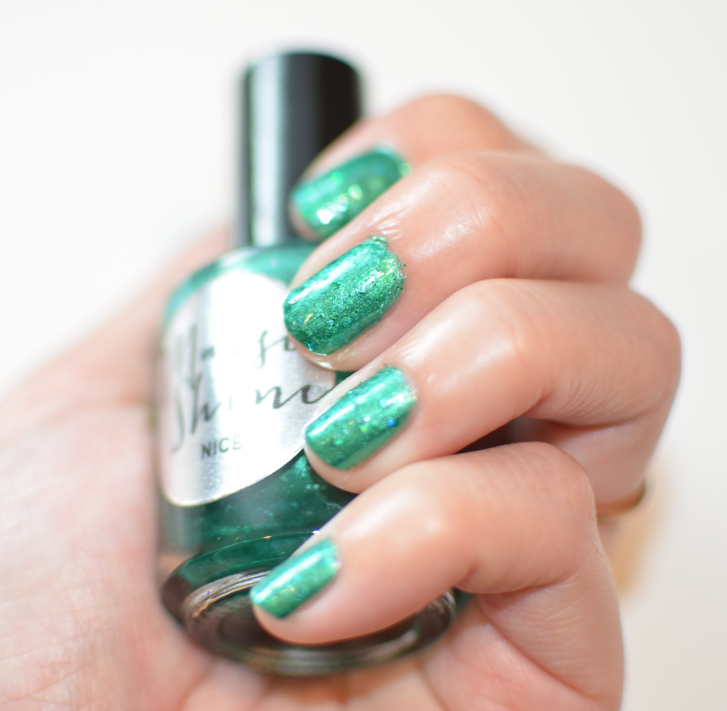 Nail Polish: Nice - Green with Teal and Green Glitters
