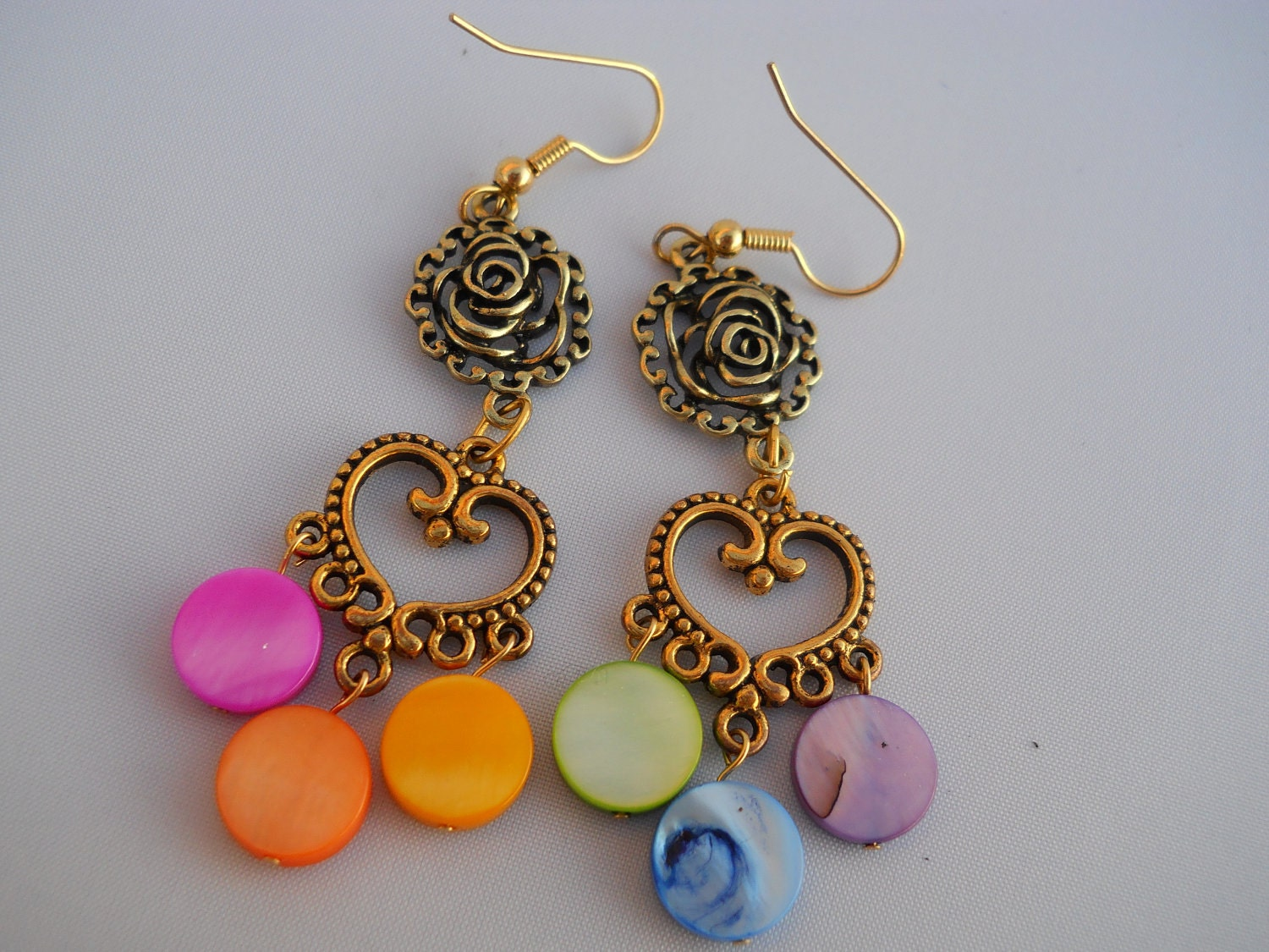 earrings: rose links, heart-shaped chandeliers, rainbow mother-of-pearl coins