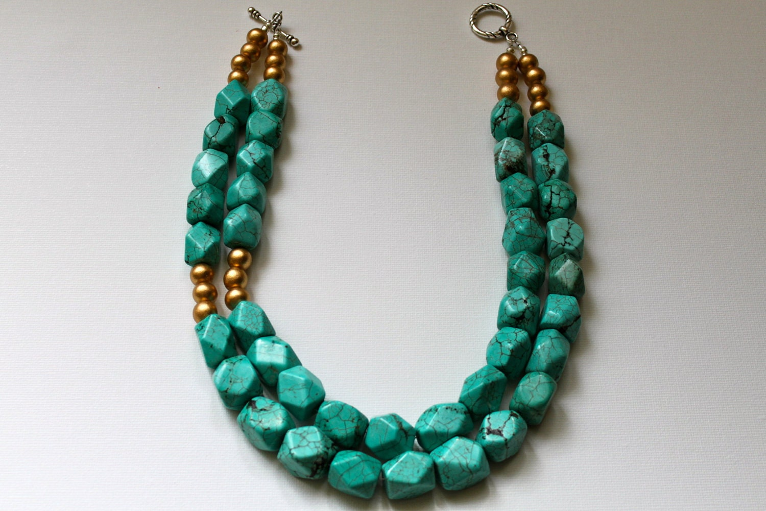 The Viceroy - turquoise howlite faceted nuggets accented with gold wood beads - ZolieDesigns