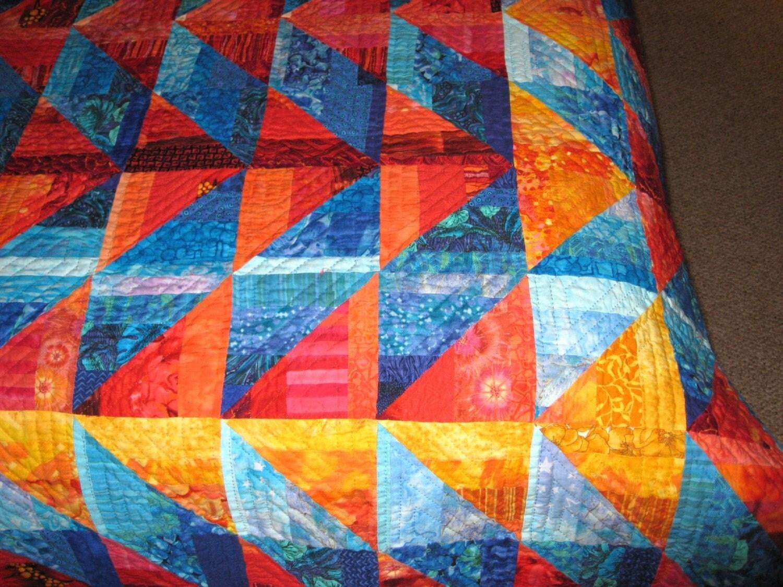 Quilt -- Orange and Gold Arrows against Blue Diamonds